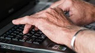 Person's hands typing on laptop computer keyboard