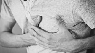 Man clutching chest with heart pain